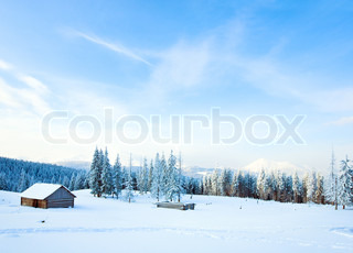 winter calm mountain landscape with shed and mount ridge behind Kukol Mount, Carpathian Mountains, Ukraine