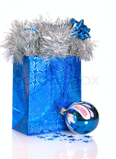 Blue gift bag with Christmas decorations on white background