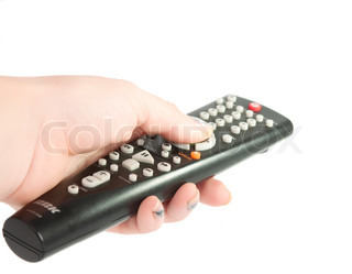 Black TV remote control in hand on a white background