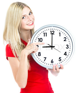 young woman holding a clock time management concept nine o`clock