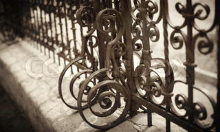 Wrought Iron Fence Detail film toned and textured photo f/x, selective focus