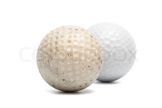 old and new golf ball on a white background