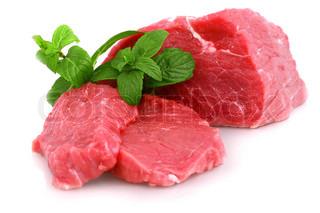 Cut of  beef steak  with green leaf.