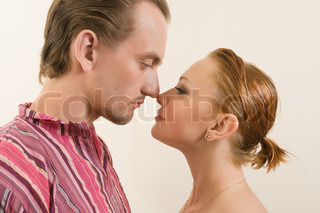 Young couple touching noses - eskimo kiss