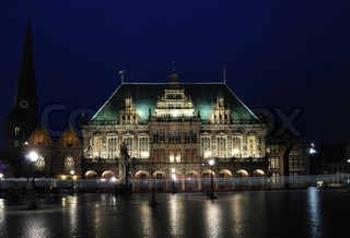 Tram passing in front of Town hall in the market square at night, Bremen, Germany