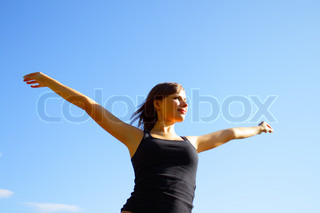 Girl on a background of blue sky