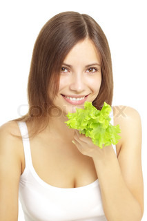 Young woman eating healthy salad isolated on a white background