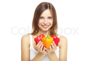 girl with bell peppers isolated on white