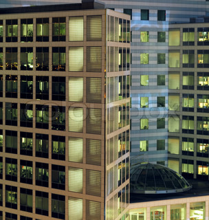 This photograph represent a modern texture of glass building at night