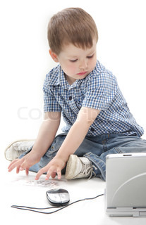 cute young boy with laptop over white