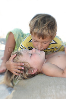 brother kissing his younger sister, partly isolated over white