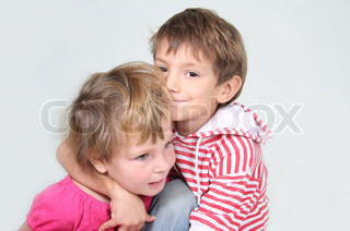 young brother and sister studio shot