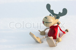Christmas deer skier in snow, clouse up