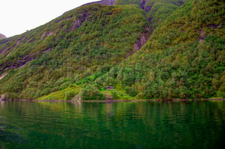 Geiranger fjord hdr with lone house near water stock photo colourbox - The house on the rock the ultimate refuge in a norwegian fjord ...