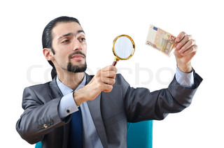 Man examining couterfeir money