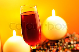 Romantic Evening - Glass of Red Wine and Burning Candles