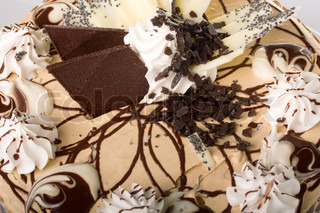 Cream cake close-up with chocolate pieces