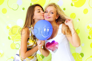 Two attractive girl with a balloon