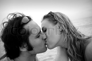 Man kissing a woman on the beach