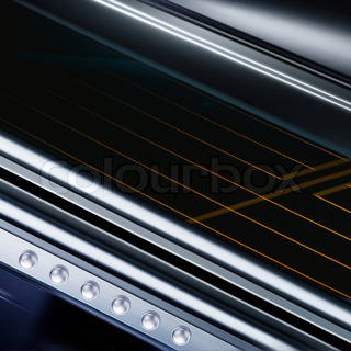shining metal texture in perspective for background with rivets