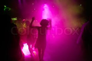 Dancing people in an night club