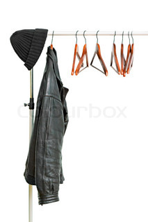 black leather jacket on a hanger isolated on white background