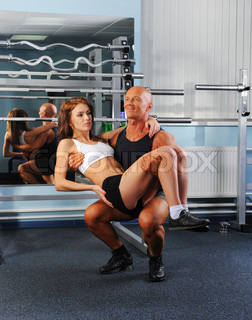 man and a woman trained in the gym