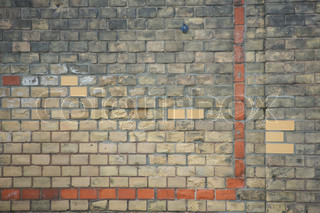 Brick wall with weathered stones
