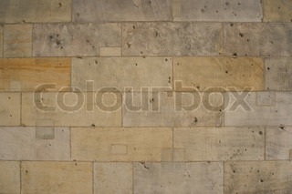 Brick wall with tiled stones