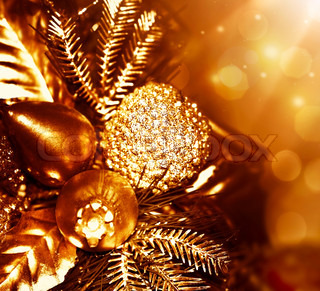 Golden Christmas tree decoration, winter holidays ornament, festive border, gold background with magic glow lights
