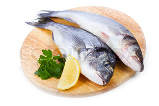 sea bass with lemon and parsley on white background