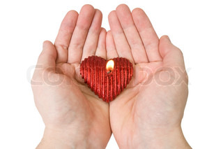Heart-shape candle in a hands Isolated on white background