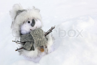 snow man toy standing close up