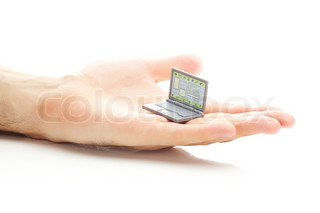 miniature laptop in hand isolated on white
