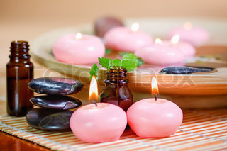 Pink candles, stones, and essential oil
