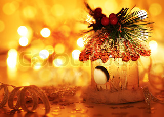 Christmas tree ornament and winter holidays decoration over blur bokeh lights, warm yellow glowing background