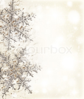 Christmas holiday background with big beautiful snowflake, Christmas tree ornament and decoration, beige card made of abstract blur bokeh magic lights, winter pattern, decorative border design