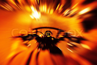 Abstract red slow motion speed background, selective focus on speedometer, night motorbike ride