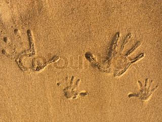 Print of hands on the sand