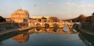 View on famous Saint Angel castle and bridge over the Tiber river in Rome, Italy