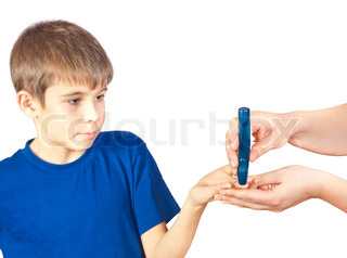 The boy is doing a test for diabetes Photo isolated on white background