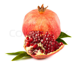 Ripe pomegranate with leaves isolated on white background