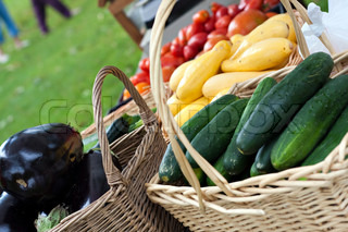 Farmers market baskets on a table full with fresh organic produce Shallow depth of field