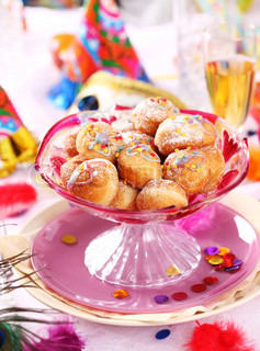 Carnival and party place setting with small fried doughnut