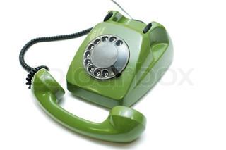Grøn gammeldags telefon på hvid baggrund