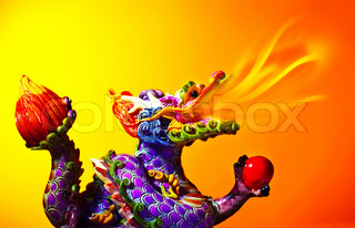 Colorful dragon head with tongue of fire flame, traditional Asian decoration and ornamental art, Chinese Zodiac, astrology sign, 2012 New Year symbol