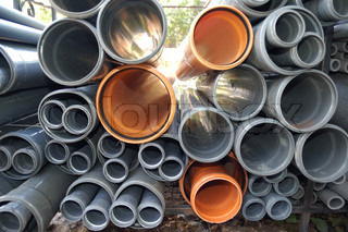 Grey and orange plastic pipes