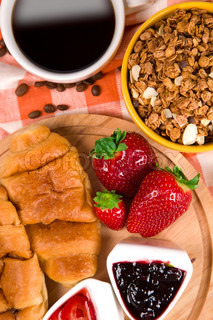 croissant with coffee, jam and berries