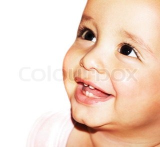 Closeup portrait of beautiful happy baby face over white background