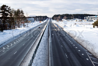 Four line highway road in winter time